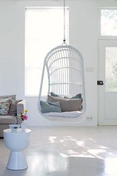 White hanging chair | Styling Marianne Luning | Photographer Tjitske van Leeuwen | vtwonen May 2010