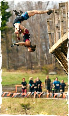Tough Mudder.  Lol, I wish I looked like that when I jumped!  I had to get pushed off!!!!