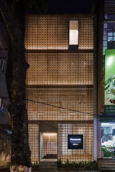 Located within Dong Da district, Hanoi, the newly constructed gallery and lighting showroom uses a perforated terracotta façade to create a simple yet significant impact on the surrounding landscape.    The gallery is located on the top floor overlooking a large neighbouring tree, while the slit skylights expose the roof garden. This offers a space for architects and design professionals to interact.    Upon entering the building, visitors are greeted with a large void. The showroom is…