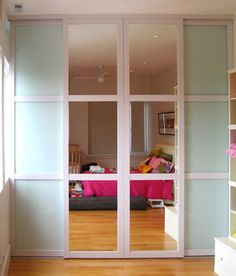 Frosted glass and mirror closet doors.