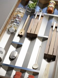 B3 trumps standard drawer-organization systems with its moveable stainless-steel and solid-wood components, which fit into V-shaped grooves in drawer inserts. Partitions in the drawers slide horizontally to accommodate varying lengths of kitchen tools and drawer widths.
