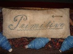 primitive...check out the valentine doll on this site. makes me smile!