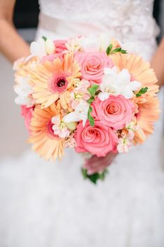 Peach Gerbera, Pink roses, White Hydrangea and white chrysanthemum bouquets. Cute Coral Gray wedding at Briscoe Manor, Houston, by Luke and Cat Photography