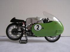 Moto Guzzi V8 with green dustbin fairing
