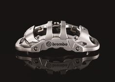 """Brembo introduces the new """"Extrema"""" caliper. Designed for a top of the line car with a strong sport vocation like the heir to the Ferrari Enzo, the new Brembo """"Extrema"""" caliper offers innovative design, reduced weight and mechatronics."""