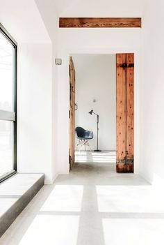Beautiful contrast between the new, abstract materials and the old wood. Stable renovation by AR Design Studio.