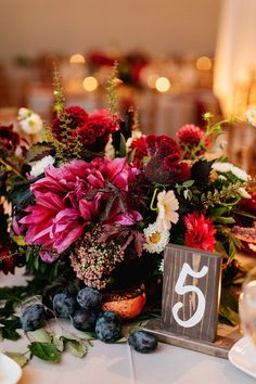 Deep reds, pinks and burgundy blooms and all that texture = one beautiful centerpiece.