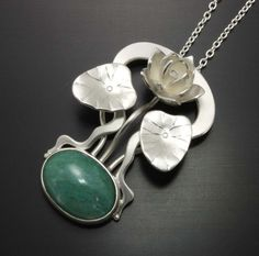 Art Nouveau style silver lotus pendant with a green chalcedony by KAZNESQ.