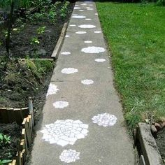 f you already have a concrete walkway that's in decent shape, but it feels a little boring, consider giving it a makeover with painted stencils. Whether you want to elicit whimsy, or bring a bold graphic to the space, you can accomplish it with minimal time, effort, and money.