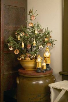 Junkyjoey  A gorgeous mixing bowl creates a prim look for a small Christmas tree!