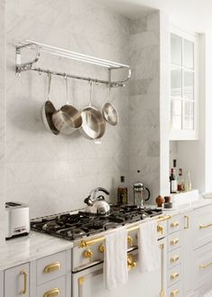 This kitchen really caught my eye on Pinterest last week; it's by Fox Force Five Construction and it's a grey & brass beauty. The La Cornue stove is a centrepiece of the space, and there is tension cr