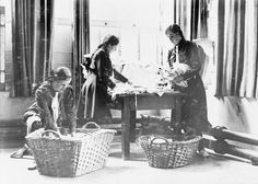 Girl Guides fold and pack laundry into baskets in the United Kingdom during the First World War. Photograph: George P. Newcastle University, Church Windows, Girl Guides, Women In History, World War I, Girl Scouts, First World, The One, Childhood