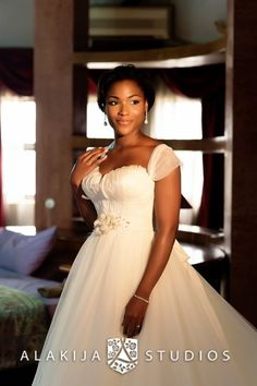 From Aisle Perfect blog. Picture by Alakija Studios. Beautiful Nigerian bride in beautiful white wedding gown for Church wedding.