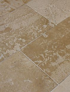 Brushed limestone floors have a distressed and weathered texture. Golden hues, heavy variation, perfect for courtyards, patios, or to achieve a rustic look indoors. Coulmier and Neuilly Jaune