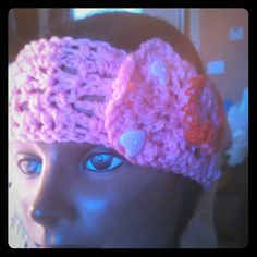 Award winning handmade crochet headband Award winning handmade crochet pink headband. This is my contribution to all Cancer survivors.  Not only is it pink, but headband has a large crochet heart with contracting adjustable button fasteners. Made with 100% acrylic yarn, created with love in a non smoking home, non allergic pets. Baglady3some Accessories Hair Accessories