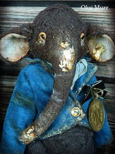 Elephant Leon By Oksana Muratova - The elephantLeon by Oksana Muratova, 21cm viscose, 5 splints, sawdust, vintage fabrics.This elephant is painted in gold paint and gold leaf. The elephant dressed in a beautiful velour jacket, which is decorated with antique medal with the image of Napoleon. The elephant ...