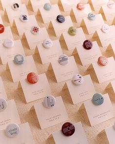 "Seating place cards - little buttons with ""mom"" ""choir boy"" etc... on them - cute!"