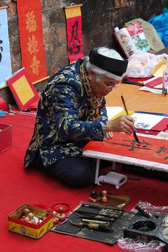 Along the wall of the Hanoi Temple, people were selling their artwork.