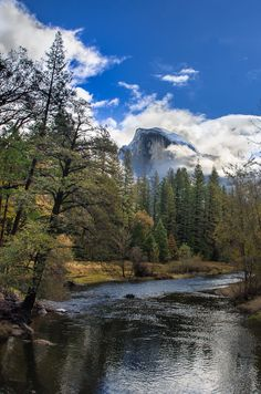 Half Dome in the clouds and the Merced River. Yosemite National Park, California