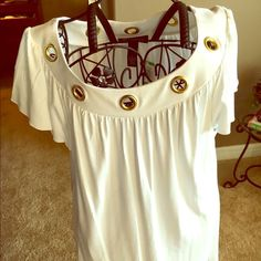 White INC top with gold rings Cute INC top, size Large. I bought it new at Macy's and never wore it. Beautiful gold circles around the neckline. This is a flowy top. INC International Concepts Tops Blouses