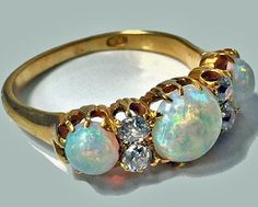 Antique 18K rose gold Opal and Diamond carved half hoop ring, C.1900.