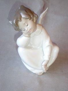 Charming Porcelain Lladro Sitting Angel Figurine