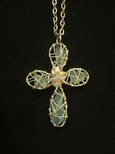 Wire-wrapped beach glass cross pendant.