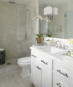 like this bathrm but with dark cabinets .                     love      hardware-