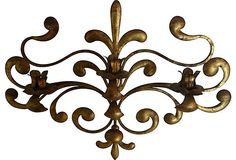"A vintage gold-leaf scroll candelabra, exclusively for candles; 25""W x 18.5""H."