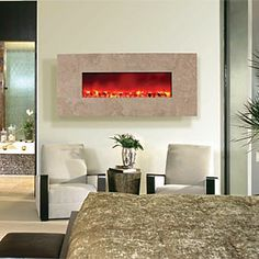 Love these wall mounted fireplaces Wall mounted electric