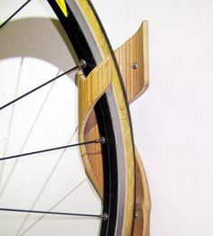 Bamboo Bike Rack - Hang your bikes vertically with sustainable style. Essence of simplicity, hand carved from 1 piece. on Etsy, $120.00