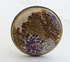 """19th Century Satsuma Hat Pins: Magnificent button formed hat pin with gilded decorated and hand painted enamelled chrysanthemums approx 12"""" long together with another (2)"""