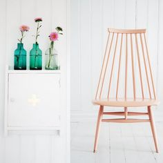 white walls and painted chair