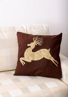Golden silhouette of a jumping deer on a brown by ThePillowWorld