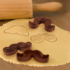 Have fun creating edible disguises! Bake the perfect look with 5 different mustache design cutters. One side cuts the shape and the other stamps the details. Molded from food-safe plastic, comes in reusable storage tray. Great conversation starters for parties! Mustache styles include: The Imperial, The Baron, The Bristle Brush, The Woolford, The Walrus, approx. 4 diameter.