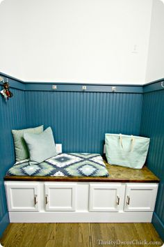 Love this for a mudroom. Especially the little cupboards on the bench for shoe storage.