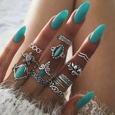 Love the rings ....not a fan of the nails