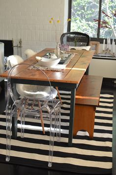 Love rug with rustic table, ghost chairs & bench. New striped rug from via High Fashion 4 Less Lucite Chairs, Woven Dining Chairs, Dining Nook, Kitchen Dining, Dining Table, Mismatched Chairs, Eames Chairs, Rustic Table, Wood Table