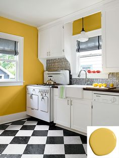 Vintage Kitchen Walls painted in Behr's Galley Gold, pressed tin back splash, vintage appliances and a black-and-white checkerboard floor complete this kitchen's retro cottage vibe. - How a novice homeowner mastered a DIY renovation of a small bungalow Farmhouse Style Kitchen, Modern Farmhouse Kitchens, Black Kitchens, New Kitchen, Vintage Kitchen, Retro Vintage, Kitchen Retro, Vintage Stove, Retro Kitchens