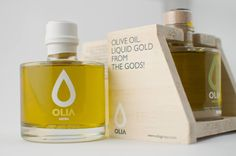 """Olive oil and gold, a combination that is becoming """"the perfect taste of  luxury."""" OLIA olive oil is a premium extra virgin oil with organic and gold  edible flakes. A beautiful package design from Redfish Inspirationsthat  combines natural wood with the extravagant look of gold speckles. The outer  rigid box combines a gold foil neck and black simplicity that houses this  olive oil perfectly."""