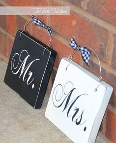 http://www.etsy.com/listing/91820722/mr-and-mrs-wooden-wedding-signs