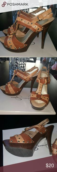 Jessie Simpson tan and gold platform sandals sz 9 Gently used. Size 9. Minor scratches around the heel that is barely visible and looks characteristic of the wooden like heel. Removable insoles. Jessica Simpson Shoes Sandals