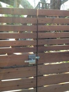 An Outswinging Contemporary Wooden Gate with the Alta Stainless Steel Gate Latch