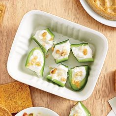Cucumbers are a wonderful alternative to crackers during snack time. For Cucumber-Feta Bites, we top them off with a little cream cheese, nonfat Greek yogurt, feta cheese, and walnuts for a protein-packed crunch. Healthy Office Snacks, Healthy Superbowl Snacks, Snacks For Work, Healthy Eating, Eating Clean, Healthy Food, Healthy Lunches, Quick Snacks, Vegan Snacks