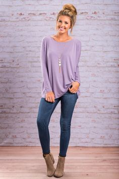 """Oh So Easy Piko Top, Lilac Gray""PIKO tops are here!! If you do not own one of these tops, you are missing out! We are loving the gorgeous lilac gray color and super soft material. You will not find a top more comfortable than this one.  #newarrivals #shopthemint"
