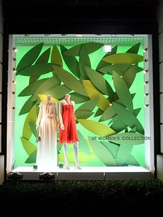 Large scale, green, simple leaves as a textural back drop. Could be made from construction paper or card board, then painted. Visual Merchandiser, styling and still life designs Fashion Window Display, Window Display Retail, Window Display Design, Retail Displays, Shop Displays, Visual Merchandising Displays, Visual Display, Vitrine Design, Store Windows
