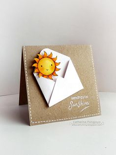 handmade card: Sending you sunshine ... kraft base card ... gel pen faux stitching ... folded envelope with sun emerging ... lub iy!