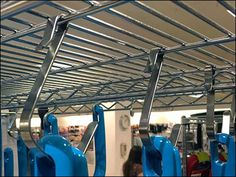 A forest of bright Blue T-Fal Cookware Custom S-Hooks here hang suspended from world-famous Metro® Super Erecta Shelving. Snake Design, Blue T, Wire Shelving, Cookware, Hooks, Shelf, Retail, Color, Diy Kitchen Appliances