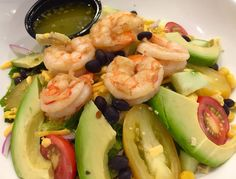 I don't know about you, but shrimp and avocado in one salad sounds like a Fiesta to me! This Mexican Shrimp Salad is a simple bead o romaine lettuce loaded with jersey mini plum tomatoes, avocado, black beans, corn, red onions, cucumber, cheddar and sautéed shrimp drizzled with cilantro lime dressing!
