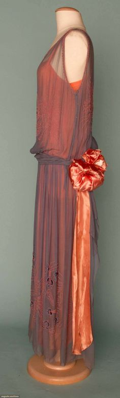 BEADED & EMBROIDERED PARTY DRESS, EARLY 1920s Powder blue chiffon over shrimp c embroidery, self-fabric waist sash,(satin waist bow shattered, pea-sized hole at back shoulder) fair. Sideway